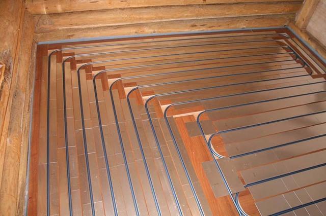 Теплый пол под ламинат: электрический и инфракрасный, подогрев из водяного отопления, укладка и можно ли класть
