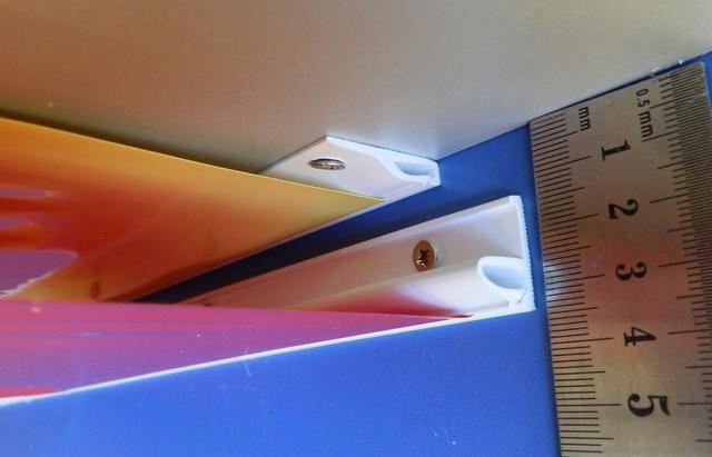 На сколько опускается натяжной потолок при установке: высота и расстояние в сантиметрах, сколько съедает, минимальный отступ от крепления